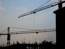 Building site 2. Silhouette of building site with 2 cranes stock images
