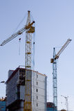 Building site. Wiht lifting cranes Royalty Free Stock Photography