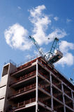 Building site. Of a part finished building in Central London. The image shows two cranes, sky background, as well as the exposed interior structure. At the stock photos