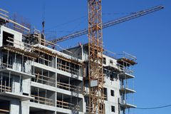 Building site. Workers and cranes Stock Images