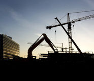 Building site. With cranes in sunset Royalty Free Stock Image