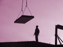 Building site. Constructing urban apartments at overtime Royalty Free Stock Images