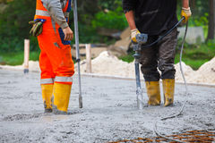 Building site compacting concrete Stock Photography