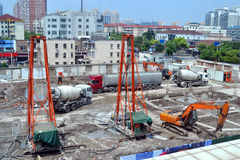 Building site. Construction site with cranes diggers cement mixers Stock Photo
