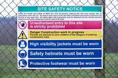 Building site construction safety notice sign on fence. Uk stock images