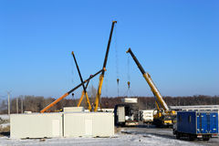 Building site. With crane trucks that unloads trucks and works on construction stock photo