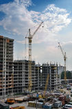 Building site with cranes. Unfinished apartment complex Royalty Free Stock Photo