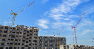 Building site with cranes. And blue sky Royalty Free Stock Photos
