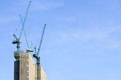 Building site with cranes and blue sky Stock Photo