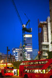 Building site with cranes in the City of London business. New development next to bank of England. Night view Stock Images