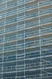 Building site facade with scaffolds and protection mesh Stock Photo