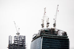 Building site. A building site with lots of construction, scaffolding and high cranes. London, England Royalty Free Stock Photography