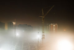 Building site in the mist of the night Stock Images
