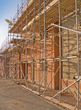 Building site - New home. Line of new houses with scaffold erected being constructed stock photography