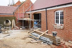 Building site UK. Building site in UK with brick house extension under construction royalty free stock photography