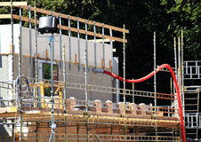 Building site with wooden barrier and red tube Royalty Free Stock Photos