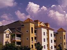 Building with sky. Condos with dramatic sky and clouds Royalty Free Stock Images