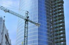 Building of a skyscraper. Building of skyscraper with glass facade and crane Stock Photo