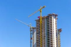 Building a skyscraper with a crane Stock Photos