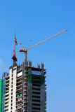Building of a skyscraper with two tower cranes Stock Photo