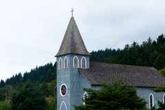 Building is small provincial Christian church with tower and cro Royalty Free Stock Image