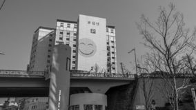 Building with a smile Seoul black and white. Seoul, South Korea - March 2018: apartment building with smiling face on the facade. Black and white royalty free stock image
