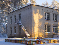 The building in the snow. The building of a kindergarten and playground in snow Stock Photo