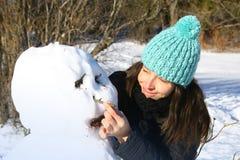 Building a snowman Stock Image