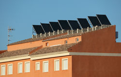 Building with solar panels. Residential building with solar panels on the roof Stock Photo