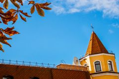 Building with a spire on a blue sky background. Royalty Free Stock Photography