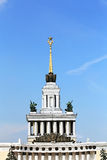 Building with a spire. White building with a spire, sculpture and decorative columns Stock Photos