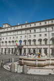 Building in the square in Rome. Rome statue with flowers in the square Royalty Free Stock Photo