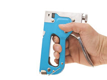 Building a stapler in a man's hand. Man's hand with a blue stapler. On a white background royalty free stock image