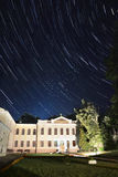 The building on the startrails background. Royalty Free Stock Image