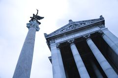 Building and statue in Rome, Italy. royalty free stock photography