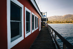 Building at Stearn's Wharf and view of mountains in Santa Barbar Royalty Free Stock Photo
