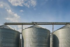 Building for storage and drying of grain crops. Agricultural Silo.  royalty free stock images