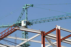 Building structure and hoist crane Stock Photos