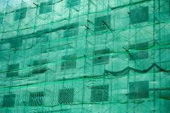 Free Building Structure With Green Netting Shade And Scaffolding Stock Photo - 171476370