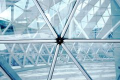 Building structures aluminum triangle geometry on facade. royalty free stock photography