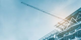 Construction site, cranes and scaffolding , concrete structure stock images