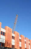 Building the suburb. Crane towering above recently constructed houses royalty free stock image