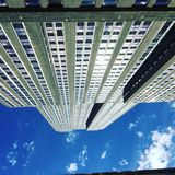 Building inverse. Building sun blue sky inverse head up royalty free stock photo