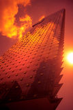 Building Sunset. Orange Sunset glowing on a tall building Royalty Free Stock Photography