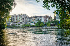 Building at sunset in central Geneva, Switzerland. Apartment buildings and Rhone river at sunset in central Geneva, Switzerland - HDR Stock Images