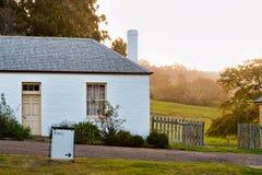 Building at sunset, Port Arthur. Old cottage at Port Arthur penitentiary at sunset stock image