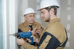 Building supervisor bugging builder Stock Photography