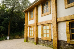 Building surfaced with planks and stones at corner of street Royalty Free Stock Photography