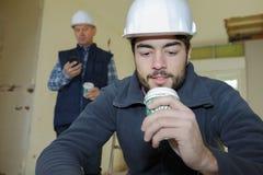 Building surveyor having coffee break Stock Photography