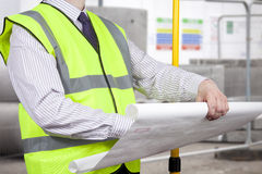 Building surveyor in high visibility inspecting construction pla Royalty Free Stock Photos